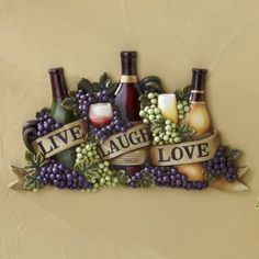 Live Laugh Love Wine Wall Art from Midnight Velvet.   The meaning of life is summed up perfectly in the three simple words on this hand-painted resin plaque.