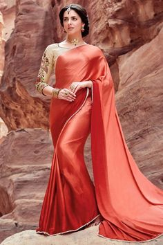 This Super Stylish Satin,Silk Fabric Saree Is Exclusively Crafted With Embroidery,Lace Work Work. The Peach,Brown Colour Saree Comes With Matching Blouse Fabric of 0.80 meters. This Saree Can Be Worn ...
