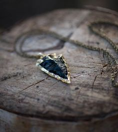 Real Obsidian Arrow Head Necklace $28.00 Photography by @meganungerphotography This Gold Plated Obsidian Arrowhead Pendant/ Gold Dipped Obsidian Arrowhead Pendant brings out your inner warrior. Made from obsidian, a naturally occurring volcanic glass, the arrowhead represents your powerful, strong and sharp personality. Don't forget the perfectly matched Crescent Moon Earrings! Material: 24K Gold Plated, Obsidian Chain Length: 74 cm
