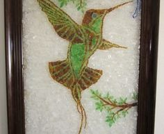 hummingbird: Dr.Jack's Sea Glass Art  Jack Sierad in woodland Hills California I make mosaics made with sea glass as well as jewelry.  I discovered Sea Glass 8 years