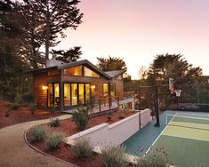 A masonry half wall with flower beds on top is a great way to create an elegant appeal to your sports area. You can make this space very attractive with the right landscaping. A tennis court may simply be the place to play your sport, but you might as well make it appealing.