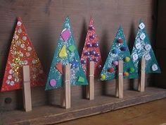 Clothespin Christmas trees. Cut out green triangles, bedeck with glitter, sequins, buttons or pompons and clip in a clothespin. Super cute and they stand on their own!