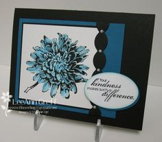 inked the flower mum stamp in Versamark and heat embossed using Black embossing powder.  Then I colored it in with a blender pen and Turquoise and Pacific Point ink