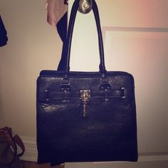 Black Handbag I've used it a few times already but now it's just sitting in my closet. It's medium size very cute and stylish for an everyday use or occasional use as well!! Call It Spring Bags