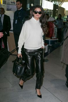 Selena Gomez in leather sweatpants and a white sweater atCharles-de-Gaulle airport in Paris on Tuesday.