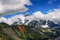 Mount Shuksan peeking from behind the clouds [OC] [6016 X 4016]