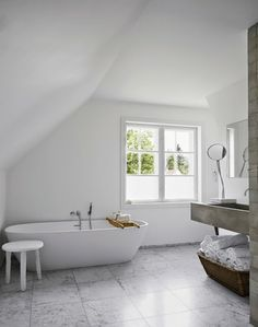 marmer floor in bathroom with a white bath  and a huge concrete sink mirror with marmer footInspiration for your bathroom   50 shades of grey#CPHart50shades