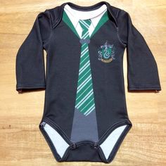 Are you absolutely in love with any and everything Harry Potter? Then youll adore this long-sleeve onesie fashioned after the Slytherin house! Made