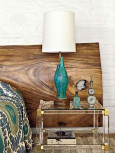 Lucite Lux® and brass side table. Gorgeous against the wood headboard.