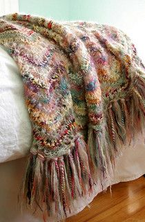 Pattern uses all of the yarns included in the kit (8 skeins of Colinette yarn in coordinating colors). There are 26 colorways available with different yarn combinations. Options include a Blocks Throw, Crocheted Throw, Diamonds Throw, Scallops Throw, Stripes Throw, Knitted Shawl