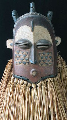 Tshimwana mask Biombo people, Congo 13 inches, stained wood  A helmet mask that fits over the head, it depicts a female character that appears along with others at initiation ceremonies, circumcision rights, and funerals.