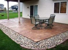 Add some small stones or gravel to the perimeter of your patio to make it be larger