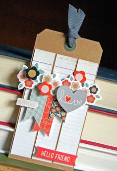 Love Tag - Scrapbook.com - Layer premade embellishments such as die cuts and layered stickers to quickly create show-stopping tags and cards.
