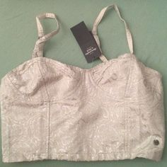 Abercrombie Floral Metallic White Crop Top NWT abercrombie metallic white crop top. Elastic back, adjustable straps. Size XS. Perfect for NYE or parties!! Price negotiable. Abercrombie & Fitch Tops Crop Tops