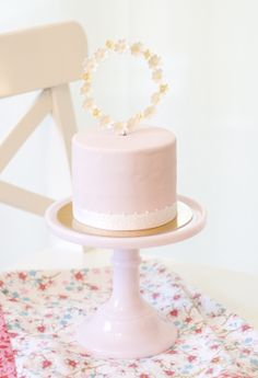 little cake with flower wreath cake topper by petite homemade
