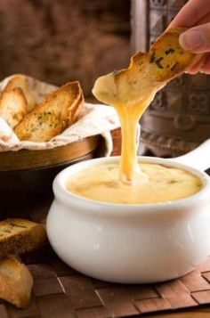 Recipe for Gouda Cheese Fondue with Herbed Crostini - Can you think of anything else better on Earth than warm, melty, gooey cheese? I didn't think so!