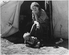 18 year-old Mother with Child During Depression by Unknown, 1937 (NARA)  It looks like the baby is eating dirt.