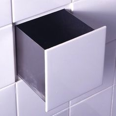 Integrate a little sneaky storage into your tile work with these functional tile cubes that were created by designers in the Netherlands.