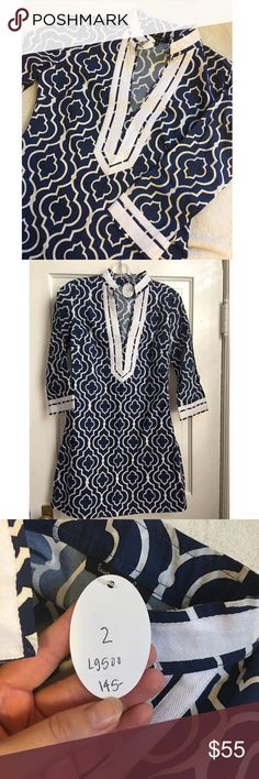 Navy and white fitted dress NWT! Purchased as a gift that didn't fit so it has never been worn. Light material with banded detail on the sleeves and collar. Very flattering neckline! Has an invisible zipper on the side for closure. Dresses Midi