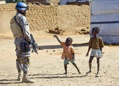 UNAMID soldier and children in Sudan