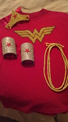 DIY Wonder Woman tiara and bracelets. Tiara: found a template on Pinterest for the shape of the crown. Then traced it onto peel &stick glitter foam… | Pinteres…