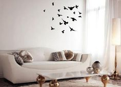 Wall stickers of birds bringing the vibe of nature to my modern living room