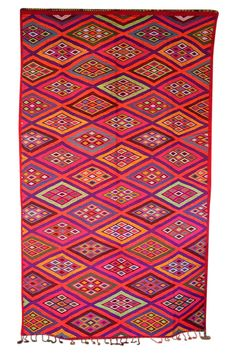 Holy moly....this is happy in a Moroccan kilim! Moroccan style has never been more playful or upbeat. This Moroccan kilim rug is all handwoven and all wool. Colors are very very bright and vivid. Available at Maryam Montague's online Souk!