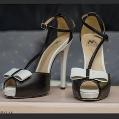 Black and White Bow Madison Heel by Shoedazzle. New condition, only used once. Very comfy and cute. Last two photos show the heels modeled. Only time I wore them Shoe Dazzle Shoes Heels