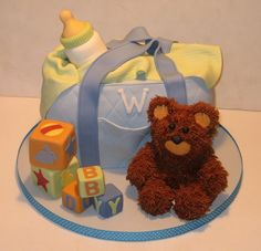 """Blue Diaper Bag Diaper bag for a baby shower. The bear was made of RKT and covered in buttercream """"fur. Diaper Bag Cake, Boy Diaper Bags, Baby Shower Cakes, Baby Boy Shower, Baby Cakes, Fun Cakes, Sweet Cakes, Yummy Cakes, Beautiful Cakes"""