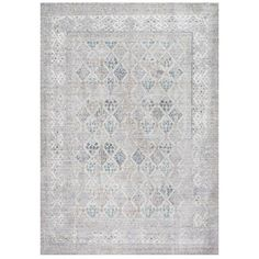 Add a pop of pattern to your living room or den with this eye-catching art silk and wool rug, showcasing a weathered diamond motif for eye-catching appeal...