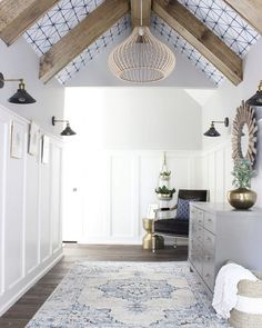 Wallpaper ceiling with wood ceiling beams in hallway. Hallway Ceiling, Ceiling Decor, Ceiling Design, Ceiling Lighting, Accent Ceiling, Upstairs Hallway, Ceiling Panels, Hallways, Painted Beams