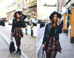 Add some color to an all-black outfit by tying a plaid shirt around the waist! (by Katarina Lilius)