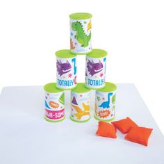 This fun game is rawr-some! Stack the cans and then try to knock them down with the bean bags. It's a classic game that most people already know. 1st Birthday Games, Birthday Activities, Dinosaur Birthday Party, Party Activities, Fourth Birthday, Baby Birthday, Birthday Ideas, Bean Bag Activities, Bean Bag Games