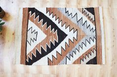/ / / vintage woven southwest textile. I love the bold geometric design and neutral earth tone colors. Its medium weight-so use it as a rug in a low traffic area, or theres a place on one side to add a dowel (not included) if youd prefer to hang it as a tapestry. / / / measures 66 x 42 or roughly 5.5 x 3.5  / / / condition: excellent vintage condition. wood dowel not included, but can be found at any hardware store  >> discover more vintage treasures here: www.experimentalvintage.etsy.com…