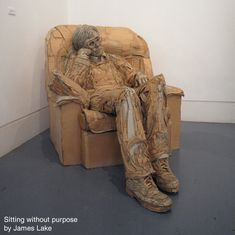 Sitting Without Purpose by James Lake.  cardboard sculpture