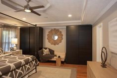 HGTV invites you to take a look at this contemporary master bedroom sitting area with an ivory chaise lounge and built-in espresso closets.