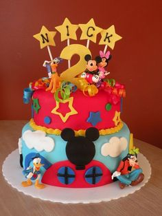 Mickey Mouse Birthday Cake This is a Mickey Mouse Clubhouse cake for a 2-year-old's birthday party. Found lots of great ideas on here...