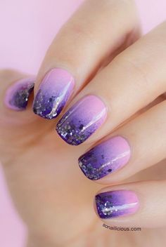 Simple but pretty violet Ombre nail art design. Choose complementing violet colors for this design and add silver glitter to highlight the darker tips of the nails.
