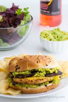 Enjoy this Vegan Chicken Sandwich with Avocados, ready in 30 minutes or less and topped with vegan cheese and vegan tempeh bacon. It's SO GOOD! #vegan #sandwich