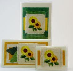 Sunflower Gift Set $32 Take the guess work out of what to buy Grandma. She is sure to love these happy sunflowers. The sunflowers are an exquisite embroidered appliqué, atop embossed papers. Set includes address phone book, checkbook, and credit card case. #giftset  #giftideas  #sunflowers  #checkbookcovers  #jadesmenagerie  #flowers