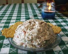 this is what I put in my crab cheese ball  crab cream cheese shredded cheddar cheese horseradish or cocktail sauce old bay worcestershire lemon water chestnuts green onions celery almond/cracker/green onion coating  serve with crackers