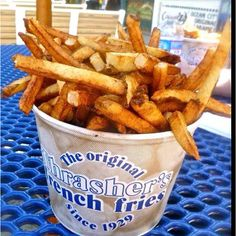 """When they finally made it to the beachside resort town, Allie pulled over at the first concession she spotted and bought an industrial-size bucket of fries and a half vat of cola.  """"Mmm, haven't had these in years. Nothing better than boardwalk fries,"""" she said, munching away happily."""