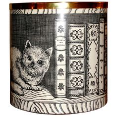 Italy  1950's  Whimsical Fornasetti object with sharp black and white image of a cat and mouse in a book shelf. Brass edge and feet. Signed in the bottom