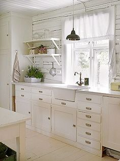 I adore the white cottage kitchen... one day my kids will be moved out and this will be mine!
