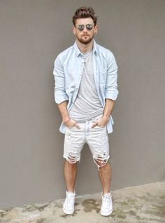 Light Grey plain Tshirt with a Light Blue Shirt on it paired with Ripped Shorts and White Converse
