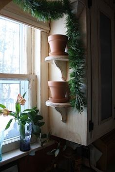 flower pot pedestals on an unused side of the kitchen cabinet. So doing this.