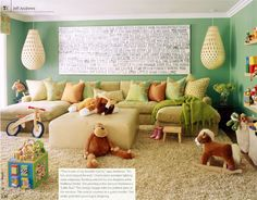Playroom? The artwork over the sofa has the lyrics of Madonna's Little Star painted on linen. Clever.