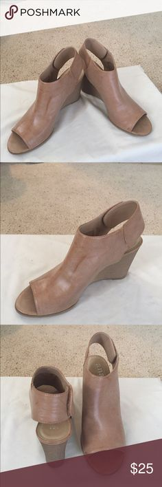 Tan Wedge sandals size 8 1/2 Never worn Never worn tan colored wedge heels. Leather like man made material. Nice soft material. Size  8 1/2.  Brand a.n.a a.n.a Shoes Wedges