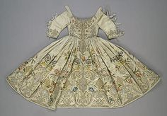 Child's Dress Embroidered with a Plant Motif   Germany or Italy. Late 17th - Early 18th century	  Silk (ground), golden, silver and silk threads; embroidery in satin stitch, patterned golden and raised laid stitch technique. L. 65 cm   Source of Entry:   Museum of the Stieglitz School (formerly in the collection of L. Ricard-Abenheimer, Frankfurt-am-Main). 1923