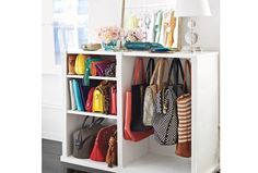 Store out of season clothes in handbags. Frees up wardrobe space and helps bags keep shape.